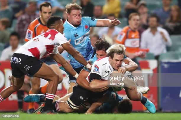 Marnus Schoeman of the Lions scores a try during the round 10 Super Rugby match between the Waratahs and the Lions at Allianz Stadium on April 20...