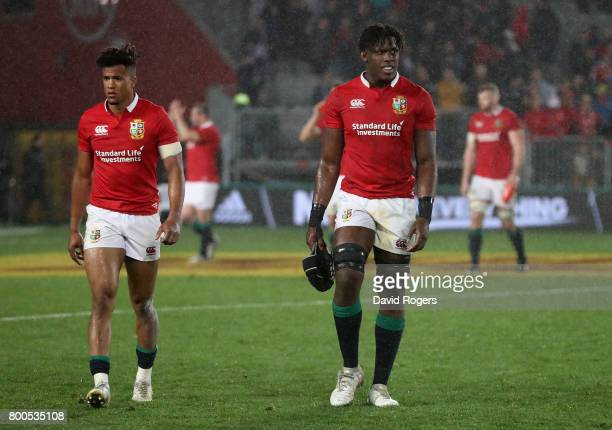 Maro Itoje and Anthony Watson of the Lions walk off the pitch after their defeat during the Test match between the New Zealand All Blacks and the...