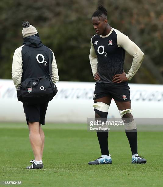 Maro Itoje consults with England physio Bob Stewart after pulling up in pain during the England training session held at Pennyhill Park on March 05...