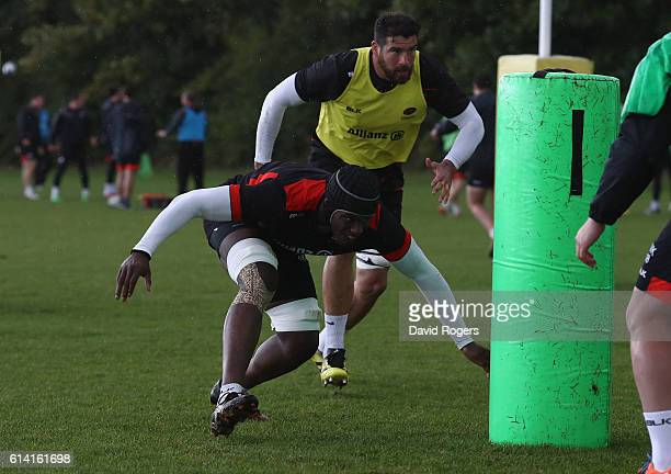 Maro Itoje hits a tackle bag during the Saracens training session held at their training venue on October 12, 2016 in St Albans, England.