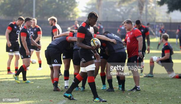Maro Itoje looks on as the team scrummage during the England training session at Kings Park Stadium on June 13 2018 in Durban South Africa