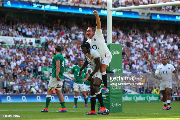 Maro Itoje of England celebrates with team mate Jamie George of England after scoring a try during the 2019 Quilter International match between...
