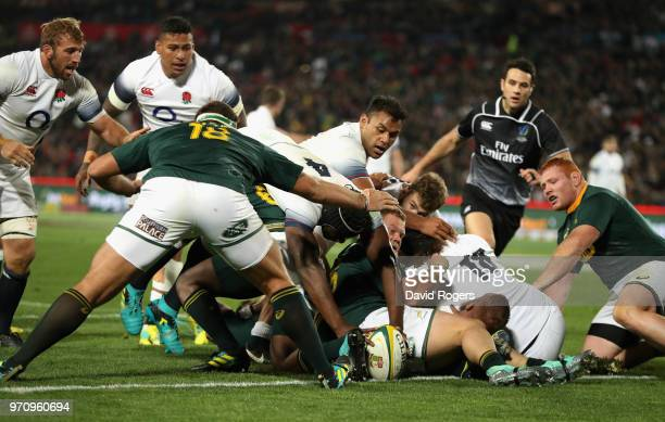 Maro Itoje of England dives to score a try during the first test match between South Africa and England at Elllis Park on June 9 2018 in Johannesburg...