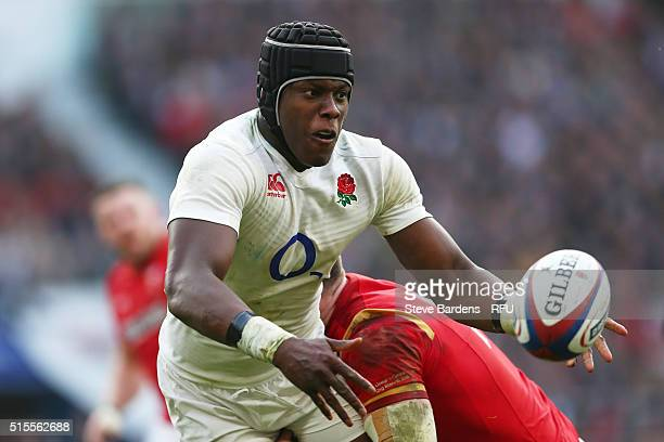 Maro Itoje of England is tackled by Alex Cuthbert of Wales during the RBS Six Nations match between England and Wales at Twickenham Stadium on March...