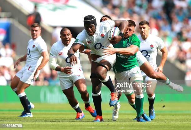 Maro Itoje of England is tackled by CJ Stander of Ireland during the Quilter International between England and Ireland at Twickenham Stadium on...