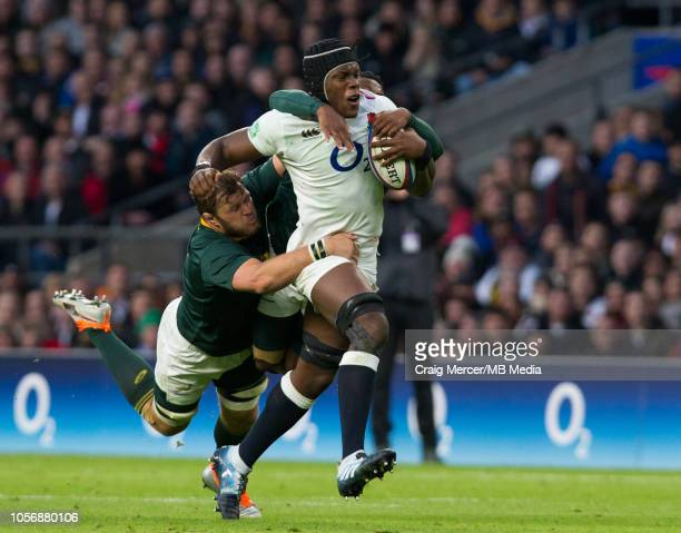 Maro Itoje of England is tackled by Duane Vermeulen and Sbu Nkosi of South Africa during the Quilter International match between England and South...