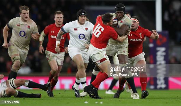 Maro Itoje of England is tackled by Elliot Dee and Wyn Jones during the NatWest Six Nations match between England and Wales at Twickenham Stadium on...