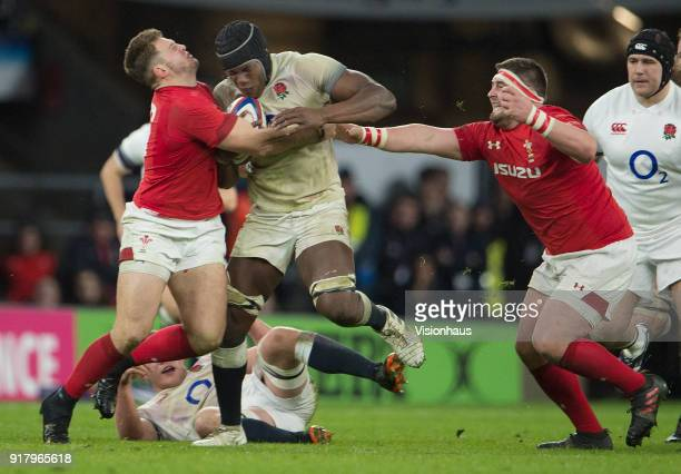 Maro Itoje of England is tackled by Elliot Dee and Wyn Jones of Wales during the NatWest Six Nations match between England and Wales at Twickenham...