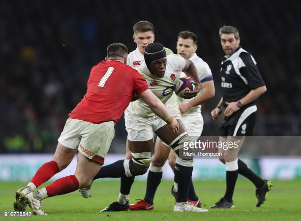 Maro Itoje of England is tackled by Rob Evans of Wales during the NatWest Six Nations round two match between England and Wales at Twickenham Stadium...