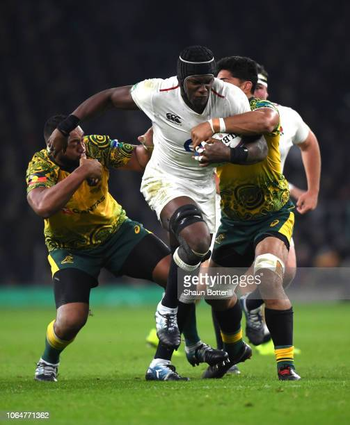 Maro Itoje of England is tackled by Sekope Kepu of Australia and Pete Samu of Australia during the Quilter International match between England and...