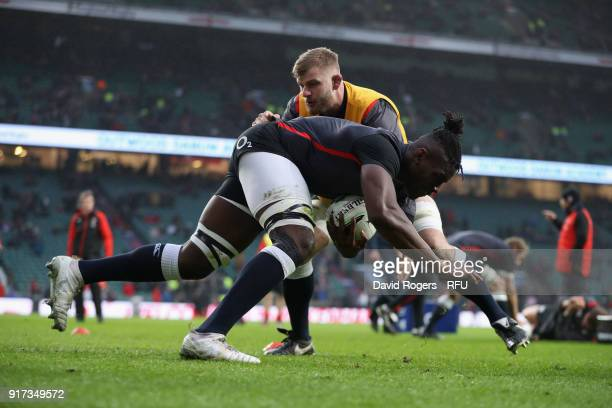 Maro Itoje of England is tackled by team mate George Kruis in the warm up during the NatWest Six Nations match between England and Wales at...