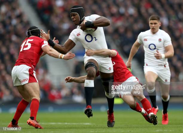 Maro Itoje of England is tackled by Tomos Williams of Wales during the 2020 Guinness Six Nations match between England and Wales at Twickenham...