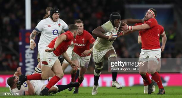 Maro Itoje of England is tackled by Wyn Jones during the NatWest Six Nations match between England and Wales at Twickenham Stadium on February 10...