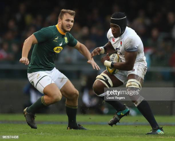 Maro Itoje of England moves away from Andre Esterhuizen during the third test match between South Africa and England at Newlands Stadium on June 23...