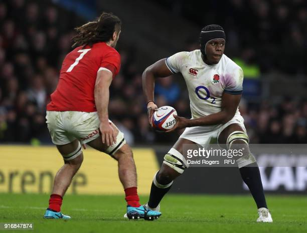 Maro Itoje of England passes the ball watched by Josh Navidi during the NatWest Six Nations match between England and Wales at Twickenham Stadium on...