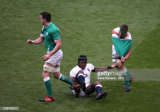 Maro Itoje of England pulls off the shirt of CJ Stander of Ireland during the 2020 Guinness Six Nations match between England and Ireland at...
