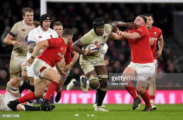 Maro Itoje of England pushes away Wyn Jones of Wales during the NatWest Six Nations round two match between England and Wales at Twickenham Stadium...