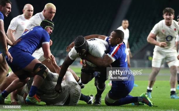 Maro Itoje of England scores their winning try despite being held by Cameron Woki during the Guinness Six Nations match between England and France at...