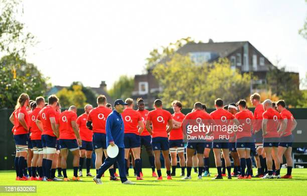 Maro Itoje of England speaks to his team mates as Eddie Jones Head coach of England looks on during a England Training Session at The Lensbury on...