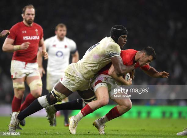 Maro Itoje of England tackles Gareth Davies of Wales during the NatWest Six Nations round two match between England and Wales at Twickenham Stadium...