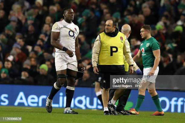 Maro Itoje of England walks off the pitch after an injury during the Guinness Six Nations match between Ireland and England at Aviva Stadium on...