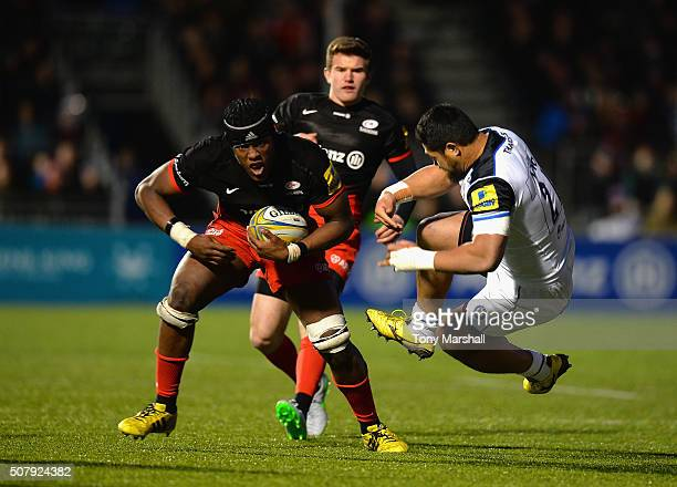 Maro Itoje of Saracens is tackled by Alafoti Fa'osiliva of Bath Rugby during the Aviva Premiership match between Saracens and Bath Rugby at Allianz...