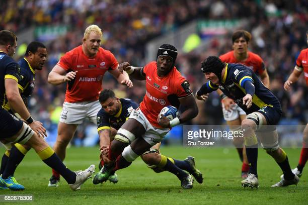Maro Itoje of Saracens is tackled by Damien Chouly of Clermont Auvergne during the European Rugby Champions Cup Final between ASM Clermont Auvergne...