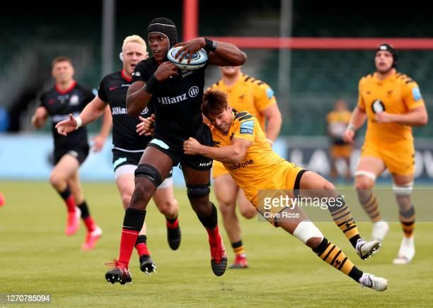 Maro Itoje of Saracens is tackled by during the Gallagher Premiership Rugby match between Saracens and Wasps at on September 05 2020 in Barnet England