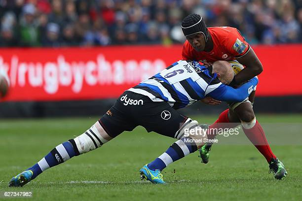 Maro Itoje of Saracens is tackled by Matt Garvey of Bath during the Aviva Premiership match between Bath Rugby and Saracens at the Recreation Ground...