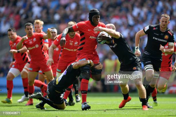 Maro Itoje of Saracens is tackled by Ollie Devoto of Exeter Chiefs during the Gallagher Premiership Rugby Final between Exeter Chiefs and Saracens at...