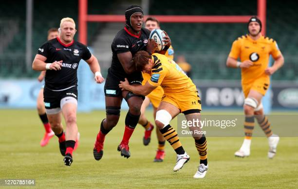 Maro Itoje of Saracens is tackled by Rob Miller of Wasps during the Gallagher Premiership Rugby match between Saracens and Wasps at on September 05...