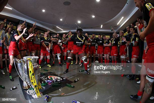 Maro Itoje of Saracens leades the celebratiuons on the dressing room after the Aviva Premiership final match between Saracens and Exeter Chiefs at...