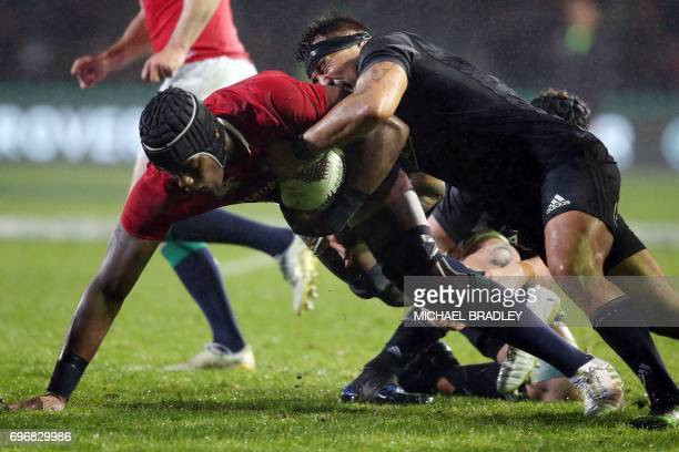 Maro Itoje of the British and Irish Lions is tackled by Ash Dixon of the Maori All Blacks during the international rugby match between New Zealand's...