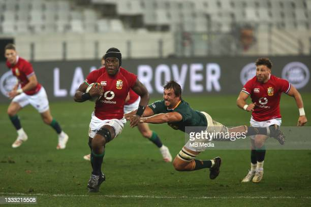 Maro Itoje of the British & Irish Lions on the attack as Eben Etzebeth of South Africa fails to make the tackle during the 3rd Test between South...