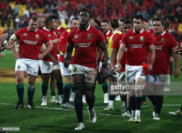 Maro Itoje of the Lions leads the team off the ptich after their victory during the match between the New Zealand All Blacks and the British Irish...