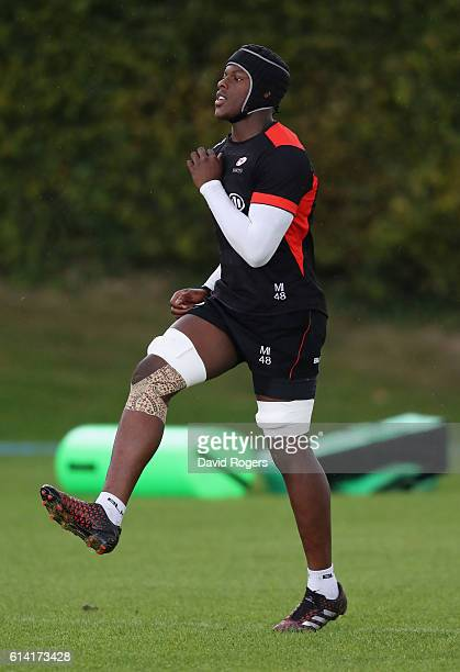 Maro Itoje warms up during the Saracens training session held at their training venue on October 12, 2016 in St Albans, England.