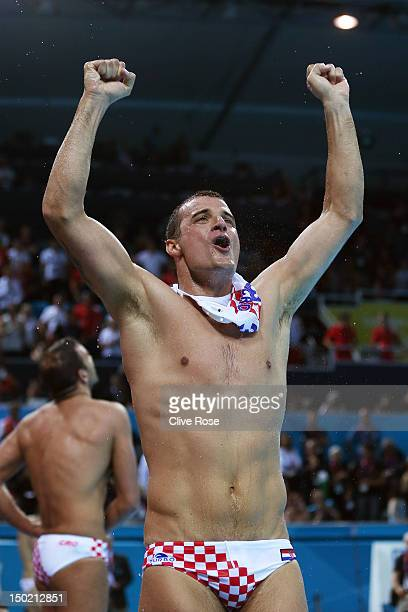 Maro Jokovic of Croatia celebrates after winning gold during the Men's Water Polo Gold Medal match between Croatia and Italy on Day 16 of the London...