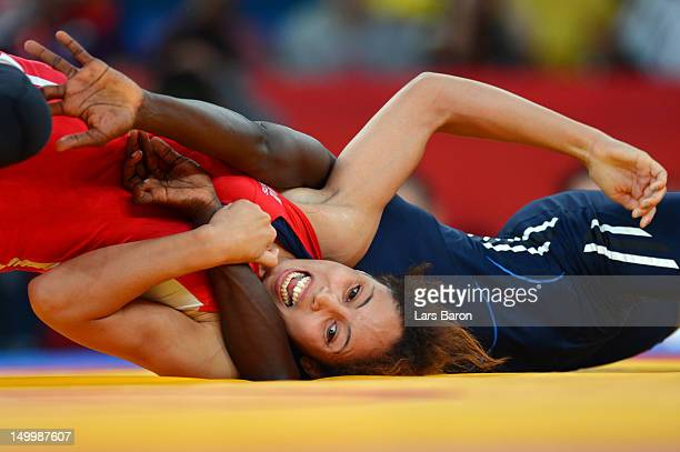Maroi Mezien of Tunisia competes against Isabelle Sambou of Senegal during their Women's Freestyle 48 kg Wrestling match on Day 12 of the London 2012...