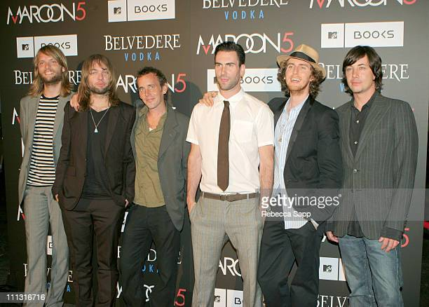 """Maroon 5 and photographer Christopher Wray-McCann during Maroon 5 Launches Their Book """"Midnight Miles"""" at Miau Haus Art Studio in Los Angeles,..."""