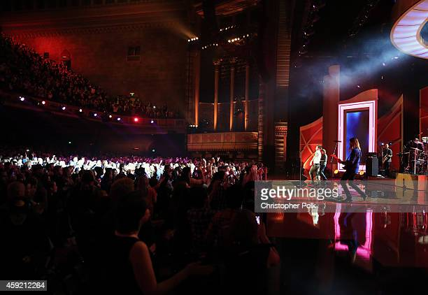 Maroon 5 performs onstage during A VERY GRAMMY CHRISTMAS at The Shrine Auditorium on November 18 2014 in Los Angeles California