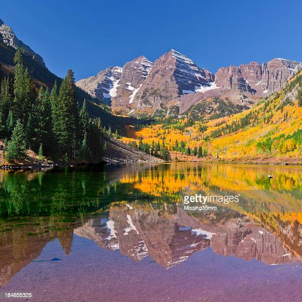 maroon bells lake reflection in fall - maroon bells stock photos and pictures