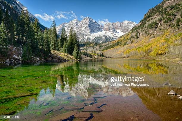maroon bells mountains reflected in a lake at white river national forest in colorado, usa. - white river national forest stock photos and pictures