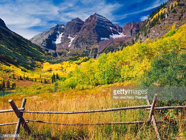 maroon bells with autumn aspen trees - maroon bells stock photos and pictures