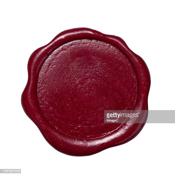 maroon colored sealing wax stamp - maroon stock pictures, royalty-free photos & images