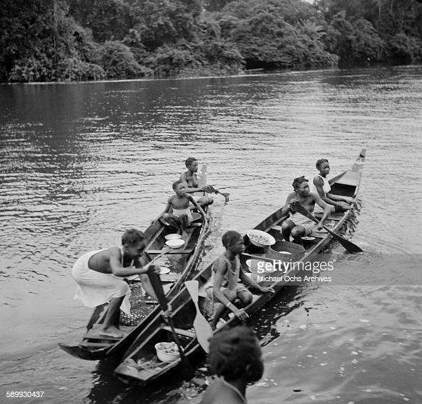 Maroon women paddle canoes The Maroon Communities are comprised of escaped slaves and indigenous peoples in Suriname
