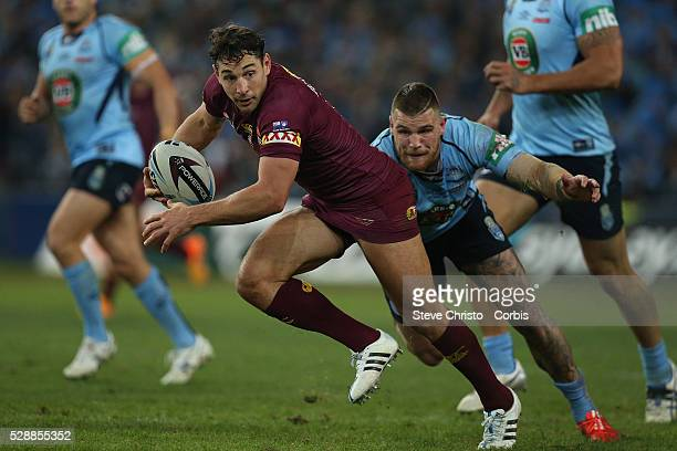 Maroon's Billy Slater is tackled by Blues Josh Dugan during the match at Sydney Olympic Park Sydney Australia Wednesday 27th May 2015