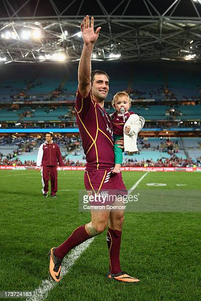 Maroons captain Cameron Smith carrying his daughter waves to the crowd after winning game three of the ARL State of Origin series between the New...