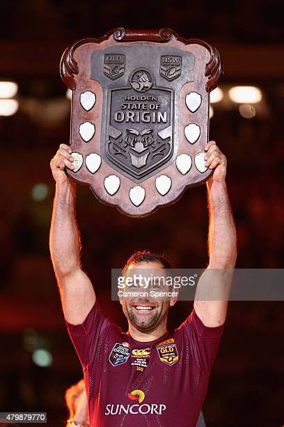 Maroons captain Cameron Smith holds the trophy aloft after winning game three of the State of Origin series between the Queensland Maroons and the...