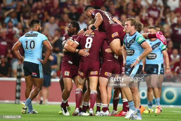 Maroons celebrate a try by Harry Grant during game three of the State of Origin series between the Queensland Maroons and the New South Wales Blues...