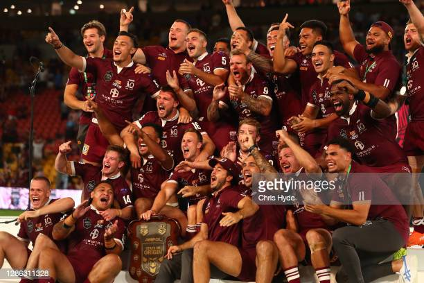 Maroons celebrate winning game three of the State of Origin series between the Queensland Maroons and the New South Wales Blues at Suncorp Stadium on...